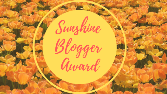 Sunshine blogger award photo of sunshine on flowers in a field