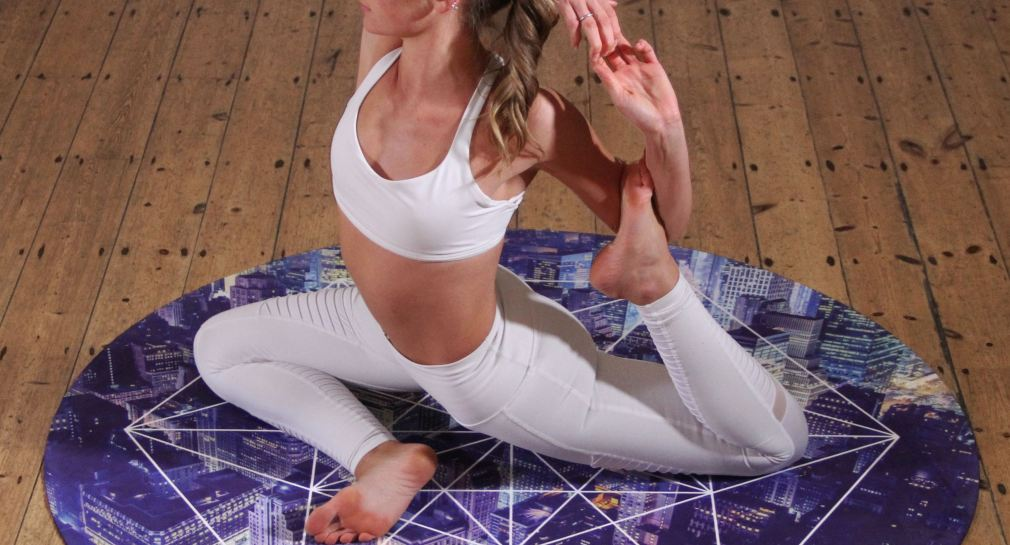Female doing mermaid yoga pose