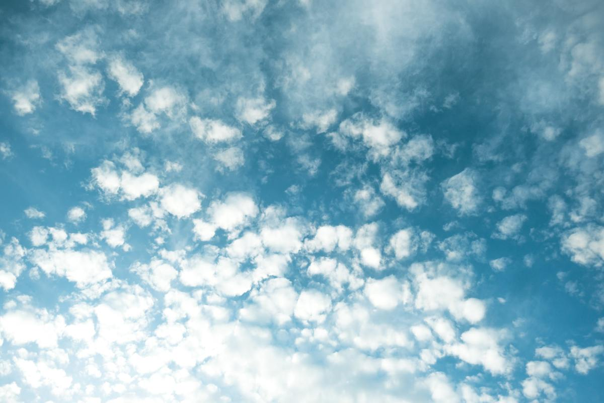 Blue sky filled with fluffy clouds