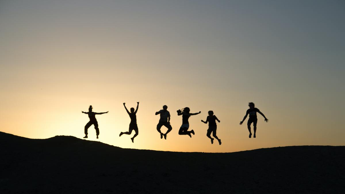 image showing friends jumping